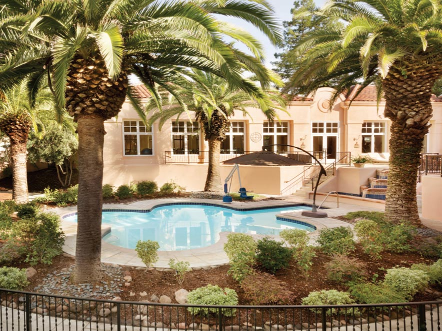 A pool under palm trees at the spa at Fairmont Sonoma Mission Inn & Spa