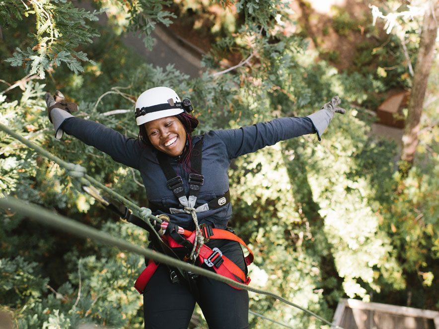 A woman rappels down to the forest floor with Sonoma Canopy Tours, Occidental