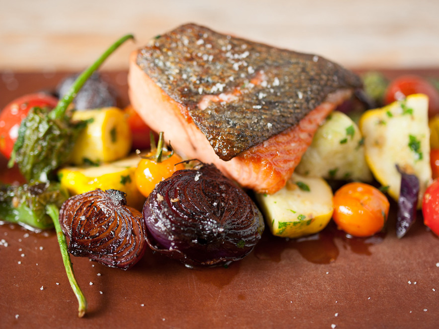 A slab of salmon sits atop a bed of vegetables at Handline in Sebastopol, Sonoma County