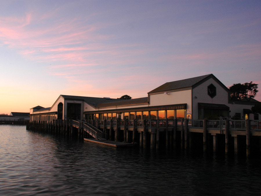 The restaurant sits along the bay at sunset