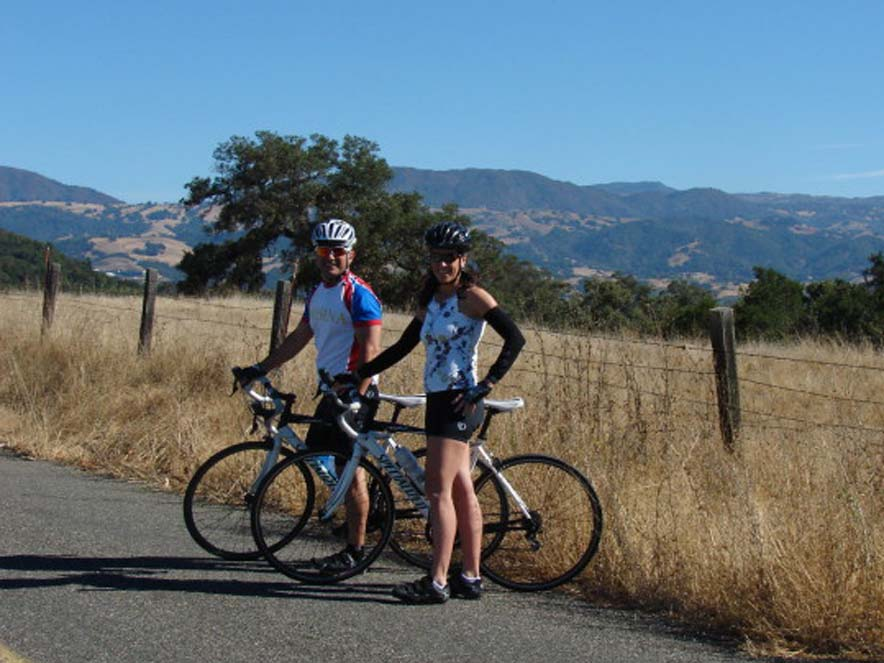 Image of two people standing near bikes from Getaway Adventures