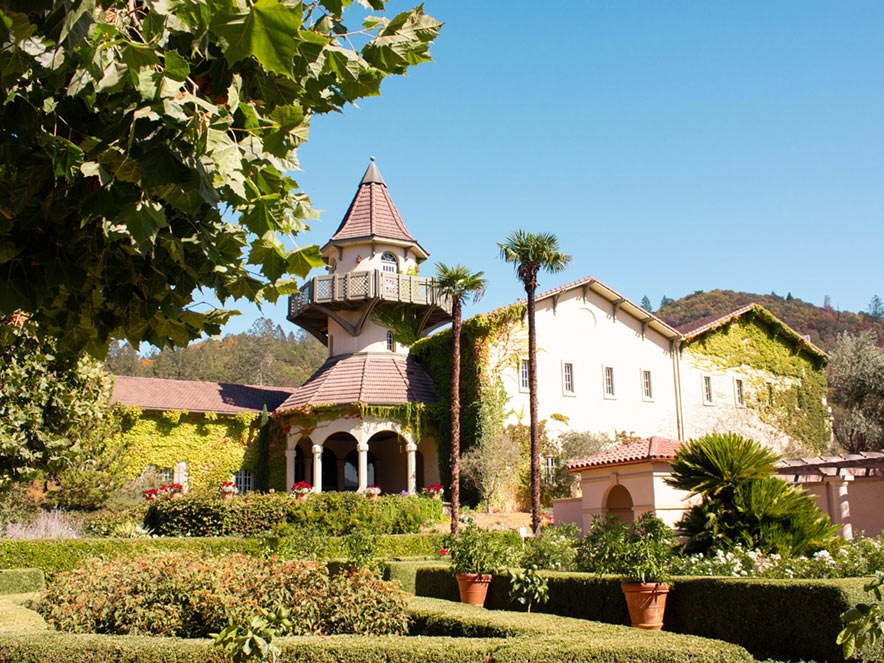 A wine castle stands with verdant trees all around, Sonoma County