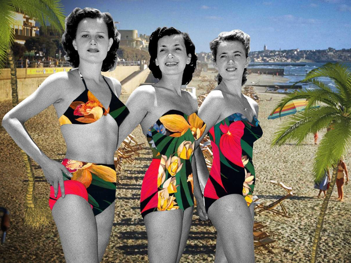 Three women in bathing suits on a beach