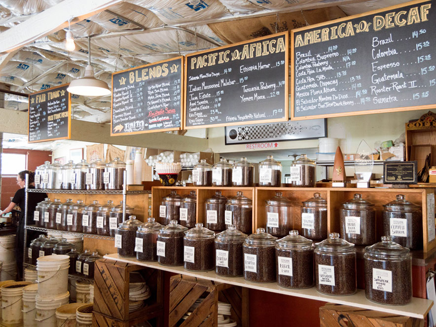 Beans stand in clear jars under a menu of the day's roasts at Petaluma Coffee & Tea Co. in Petaluma, Sonoma County, California