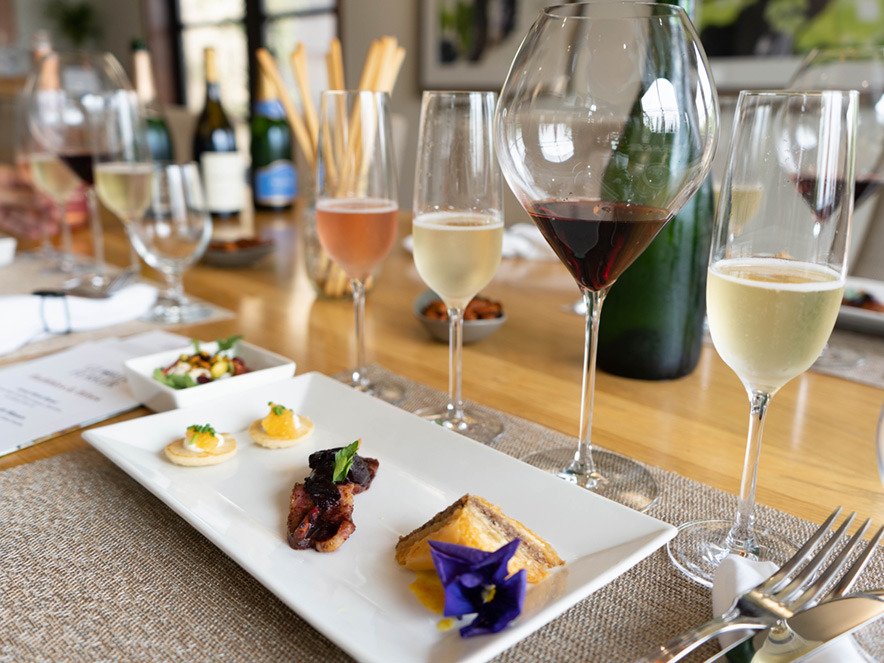 Food pairing featuring three sparkling wines, a Pinot Noir, a creme fraishe and caviar bite, a bacon bite, and a baklavah bite at Gloria Ferrer Winery in Sonoma County, California