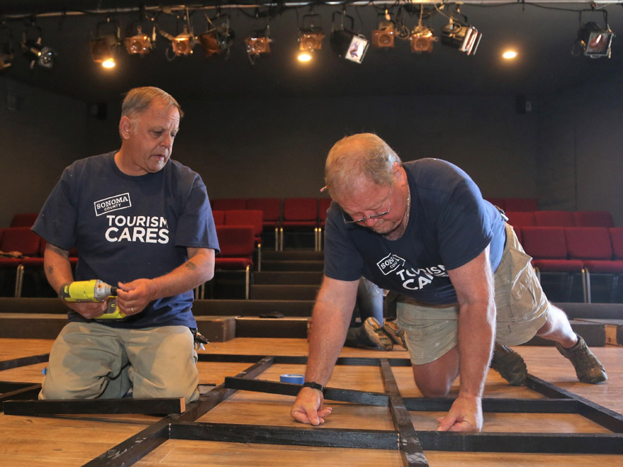 Two men working on a set at Left Edge Theatre.