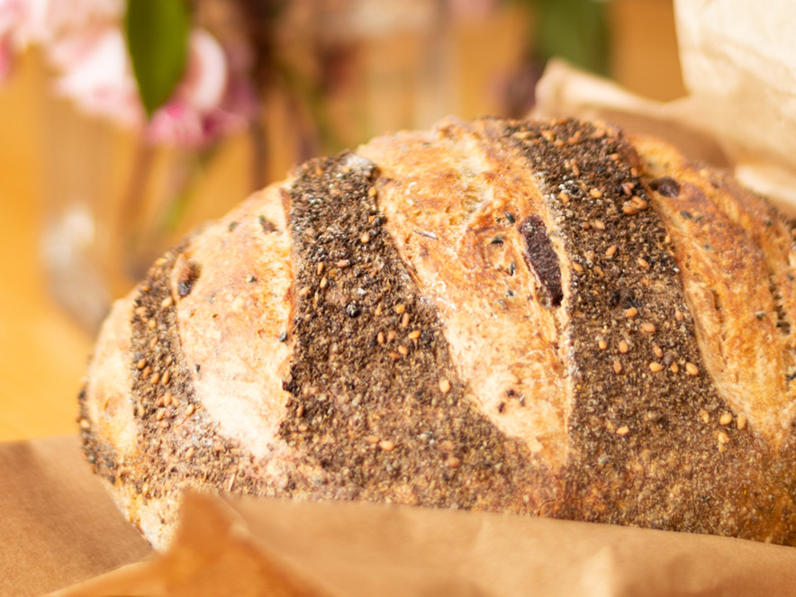 Close up of a seeded loaf of bread at Wild Flour Bakery, Sonoma County, California