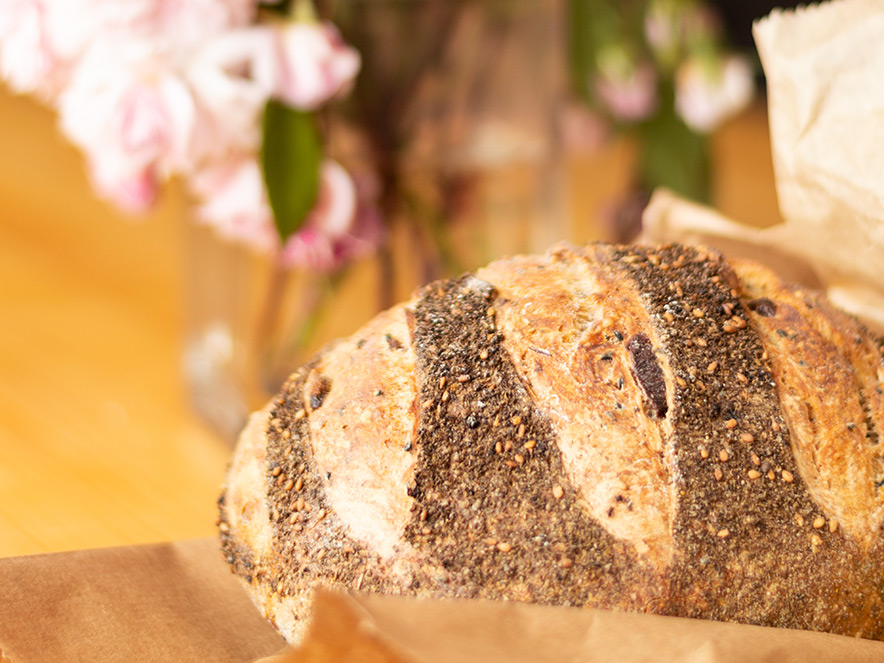 Image of fresh seeded loaf of bread at Wild Flour Bakery in Sonoma County