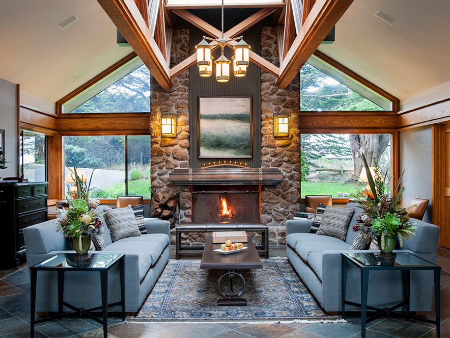 Couches and a cozy fireplace inside Bodega Bay Lodge