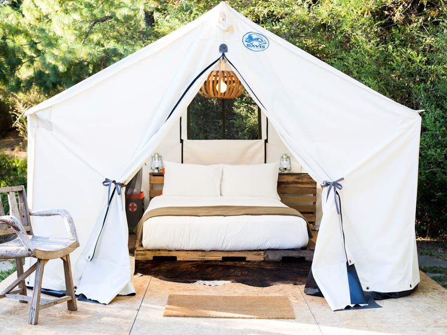 A luxurious glamping tent is surrounded by trees at boon hotel + spa, Guerneville