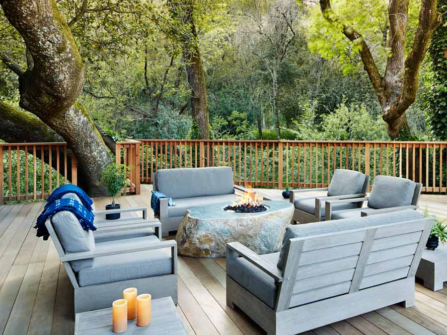 Lounge chairs surround a fire pit at Gaige House + Ryokan, Glen Ellen