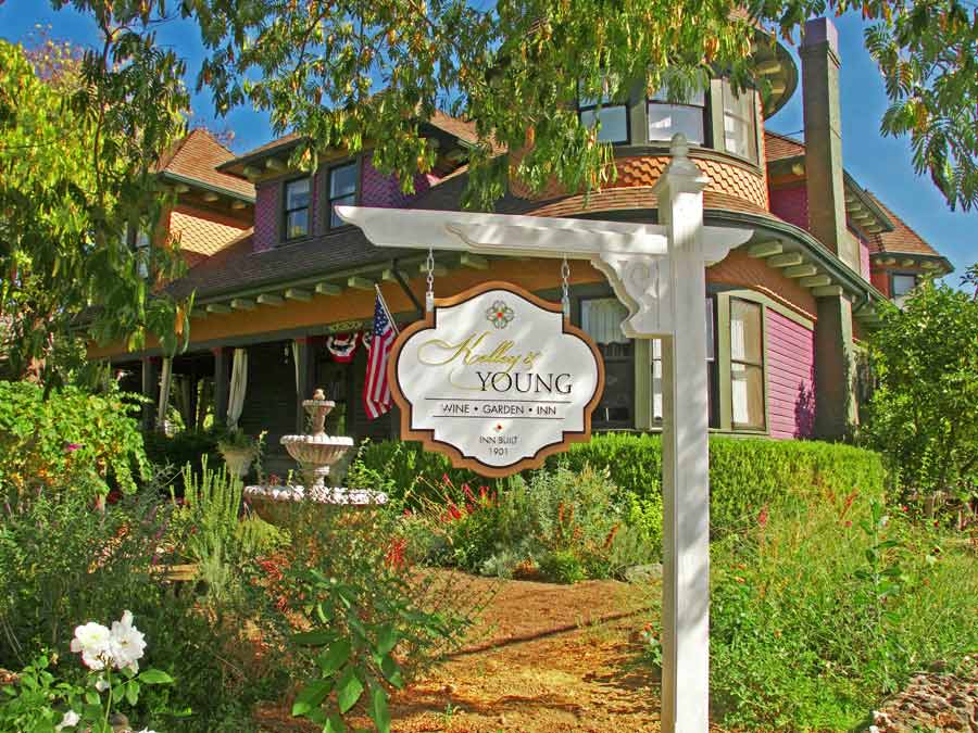 The sign and gardens in front of the Kelley & Young Wine Garden Inn, Cloverdale