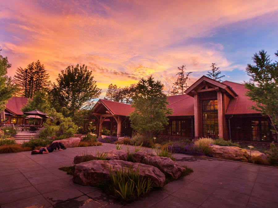 The exterior of the retreat center glows in the setting sun in Sonoma County