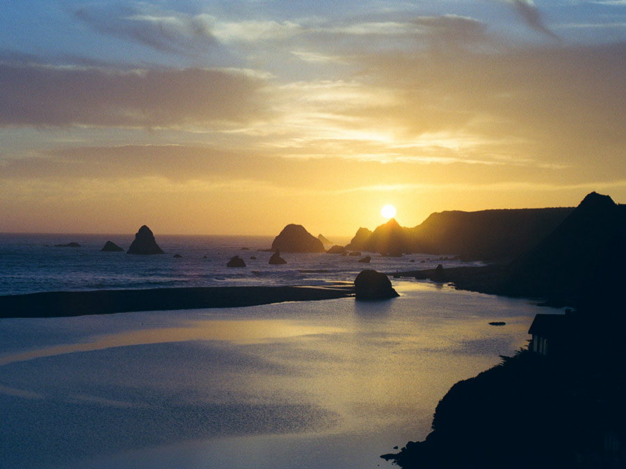 The sun sets in Jenner, where the Russian River meets the Pacific Ocean