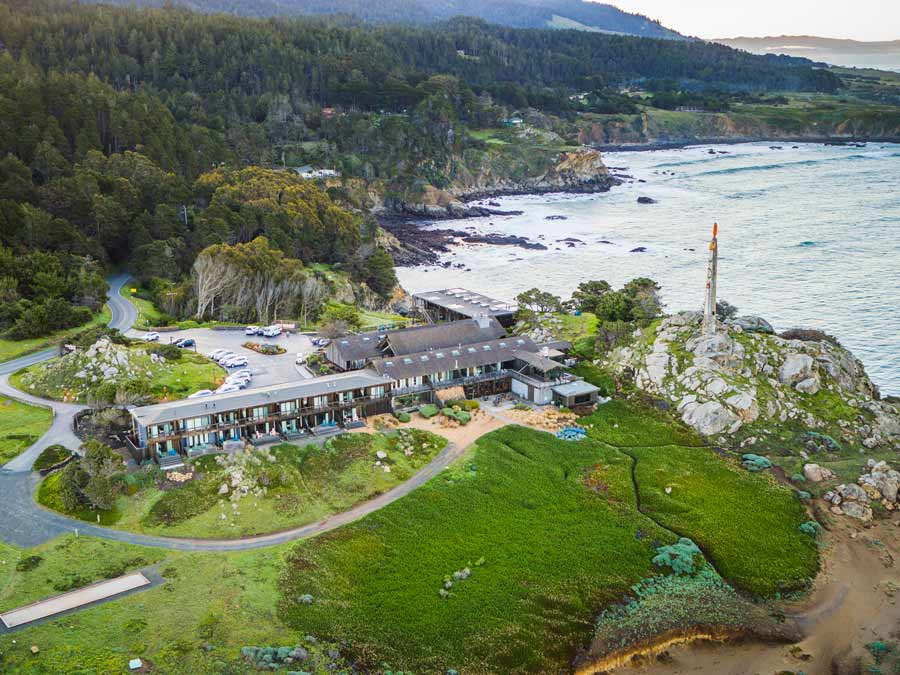 An aerial view of the dramatic Timber Cove Resort perched along the coast in Sonoma County