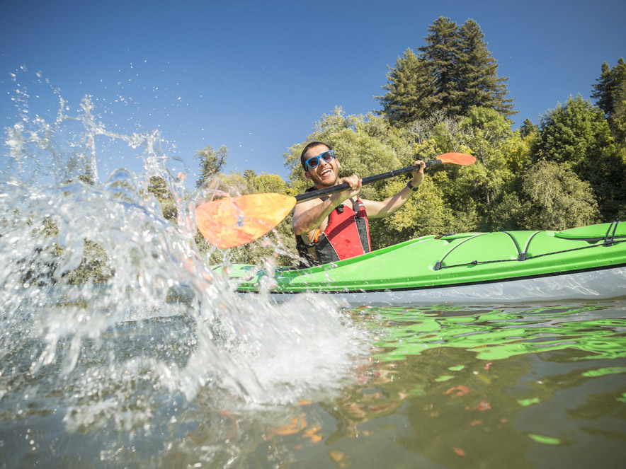 man splashing water from Canoe in Sonoma County