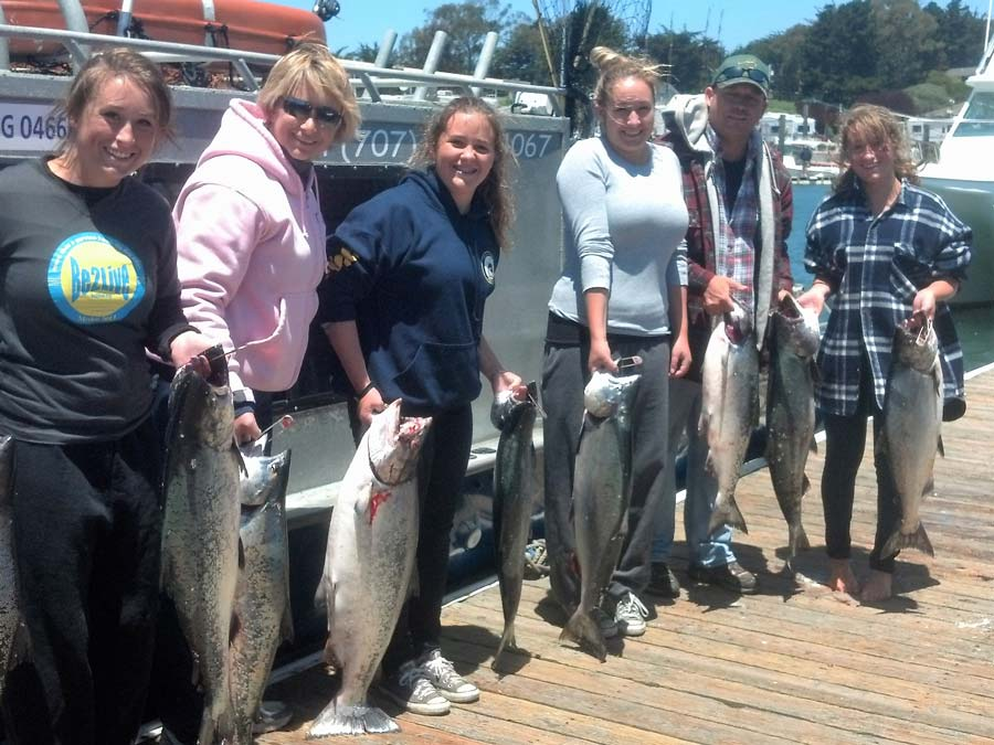A group holds their catch for the day with Fish On Charters, Bodega Bay