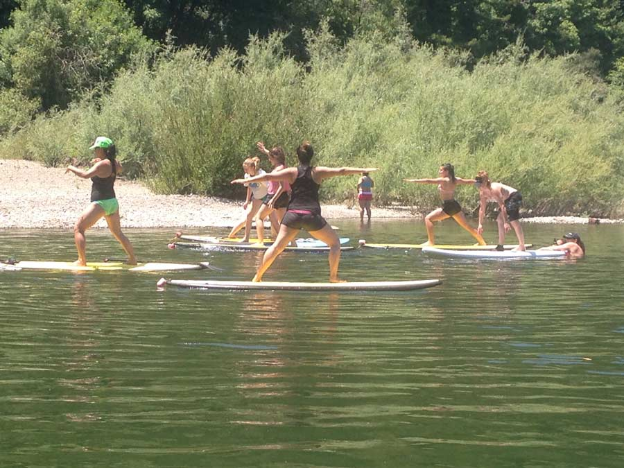 People do yoga on paddleboards in the Russian River in Sonoma County