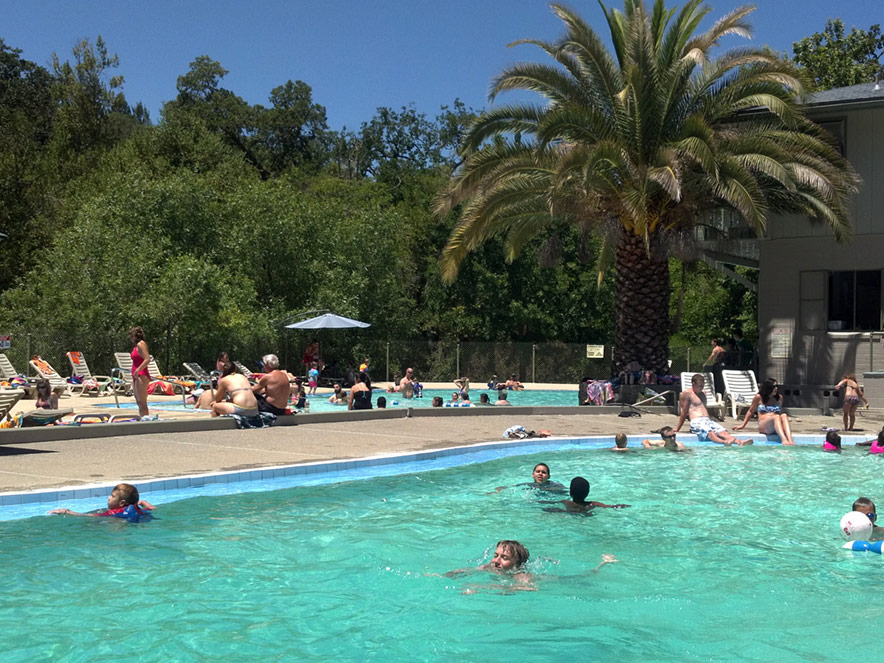 Children swim in a hot pool at Morton's Warm Springs