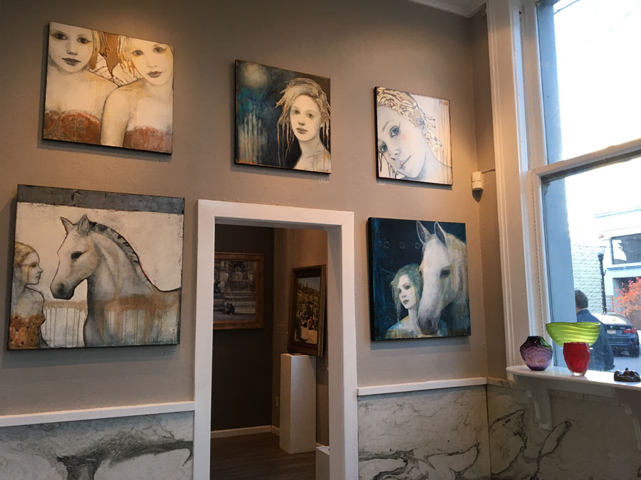 Paintings of horses adorn the walls at the Stafford Gallery in Healdsburg, Sonoma County