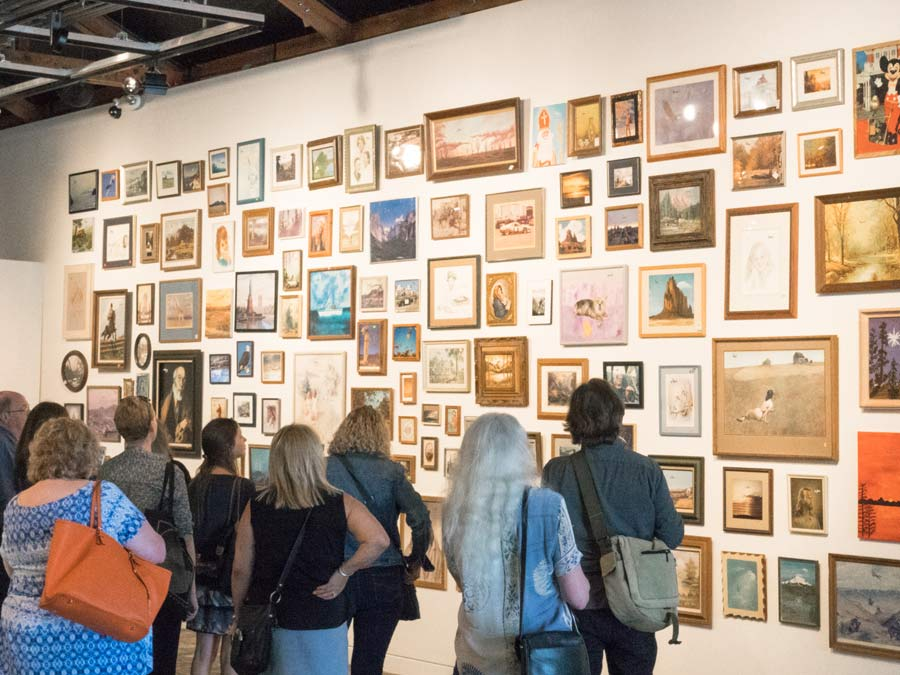 A group loooks at art adorning the wall at the Sonoma Valley Museum of Art in Sonoma County