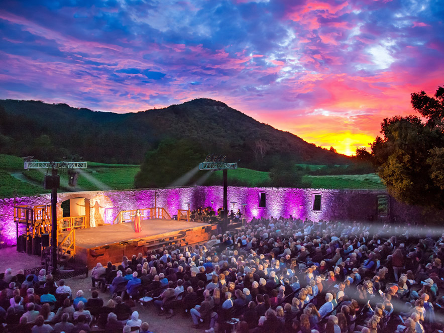 A vibrant sunset sky hands over the outdoor theater in Jack London State Park where Transcendence Theatre performs