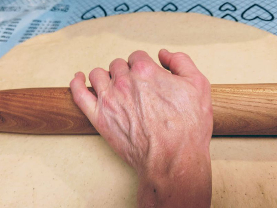 Image of dough being rolled.