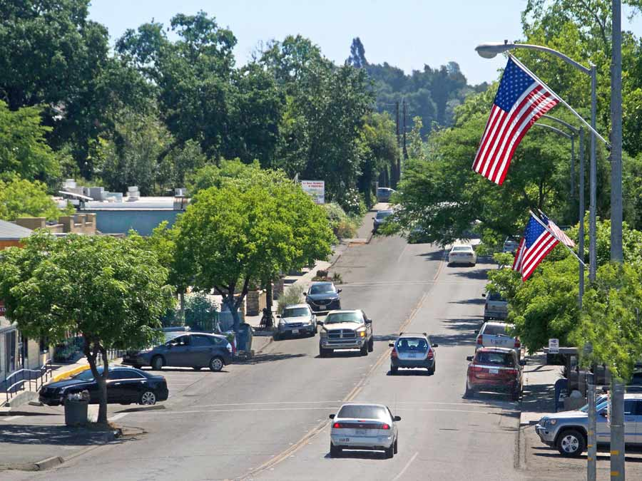 Crs drive down the cute main street lined with American flags in Forestville, Sonoma County