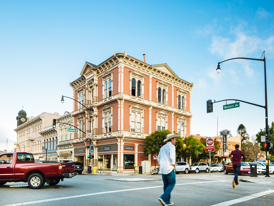 A man walks in the vibrant downtown of historic downtown Petaluma