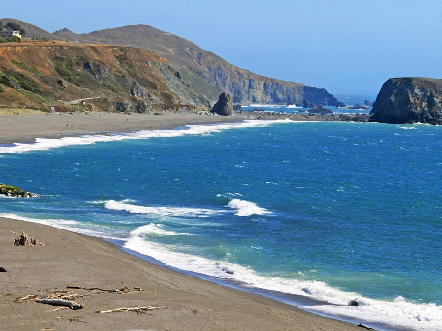 The large rock sits just outside from the shore where the Russian River meets the ocean in Sonoma County