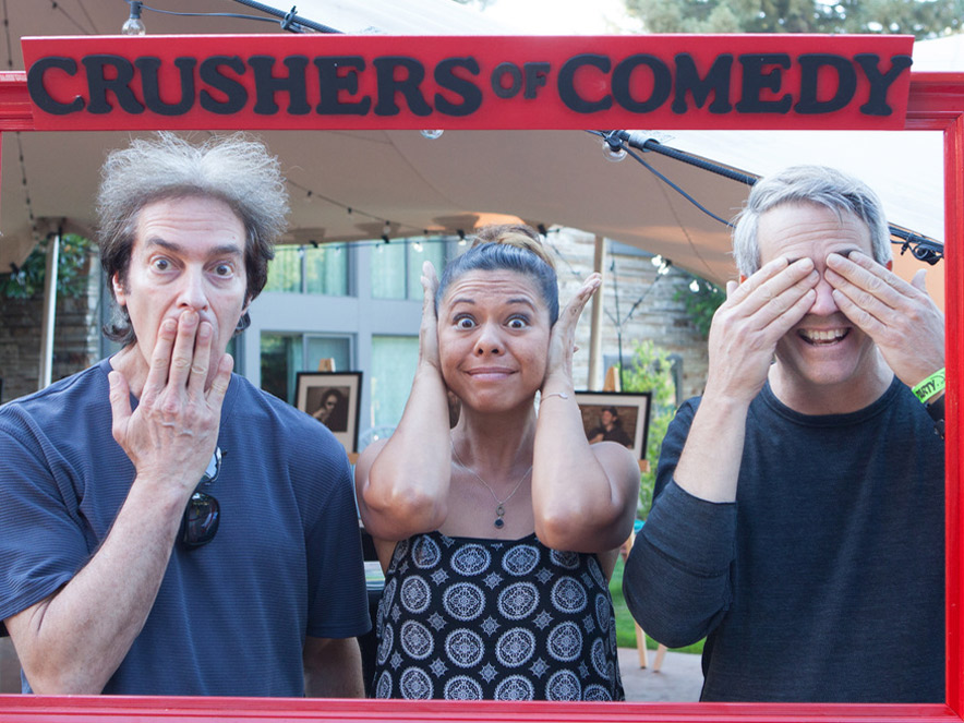 Comedy Crushers comedians posing in photo frame in Sonoma County