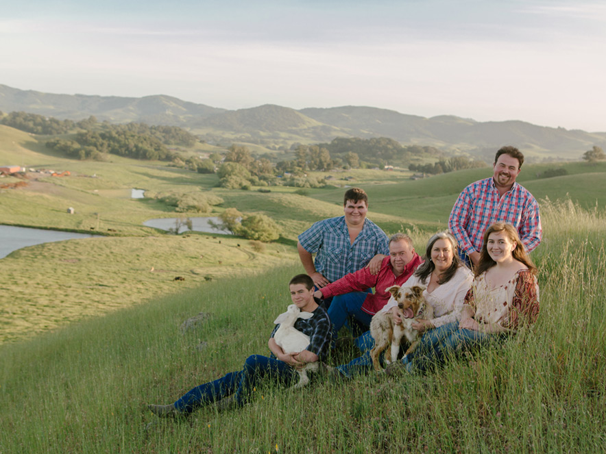 The Achadinha family poses for a portrait in the fields of their pastures on their dairy farm in Petaluma, California