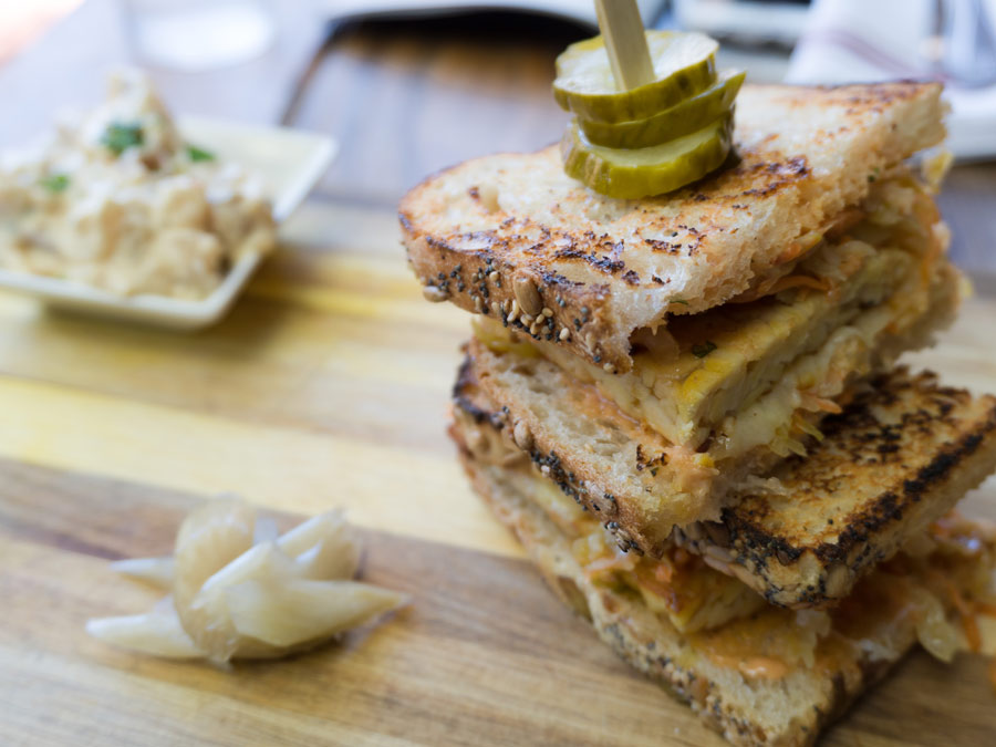 A tempeh sandwich at Backyard in Forestville, Sonoma County, has pickles on top