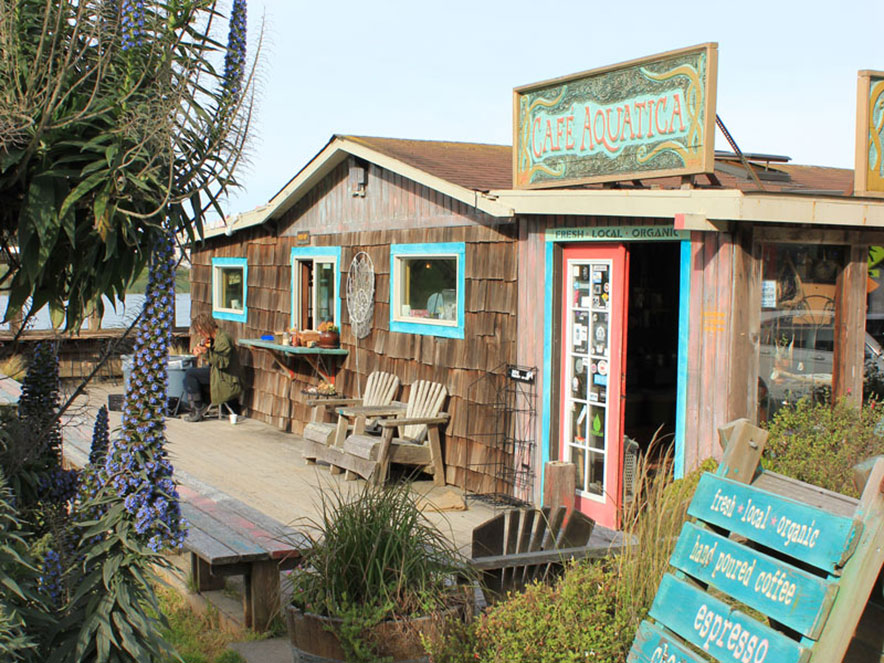 A cafe with wooden shingles and brightly coloured eaves stands near the ocean in Sonoma County, California