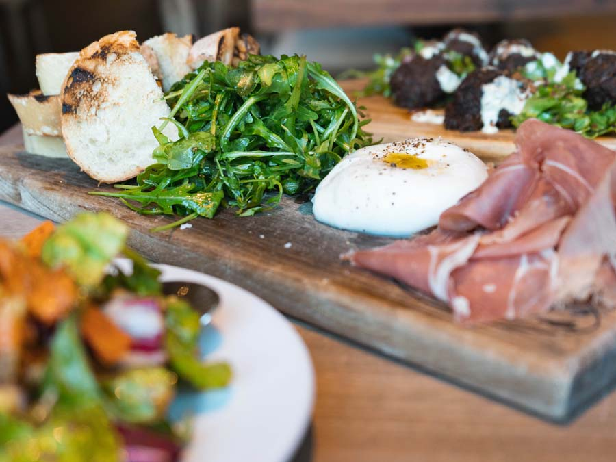 Burrata, proscuitto, and arugula served as an appetizer in Sonoma County