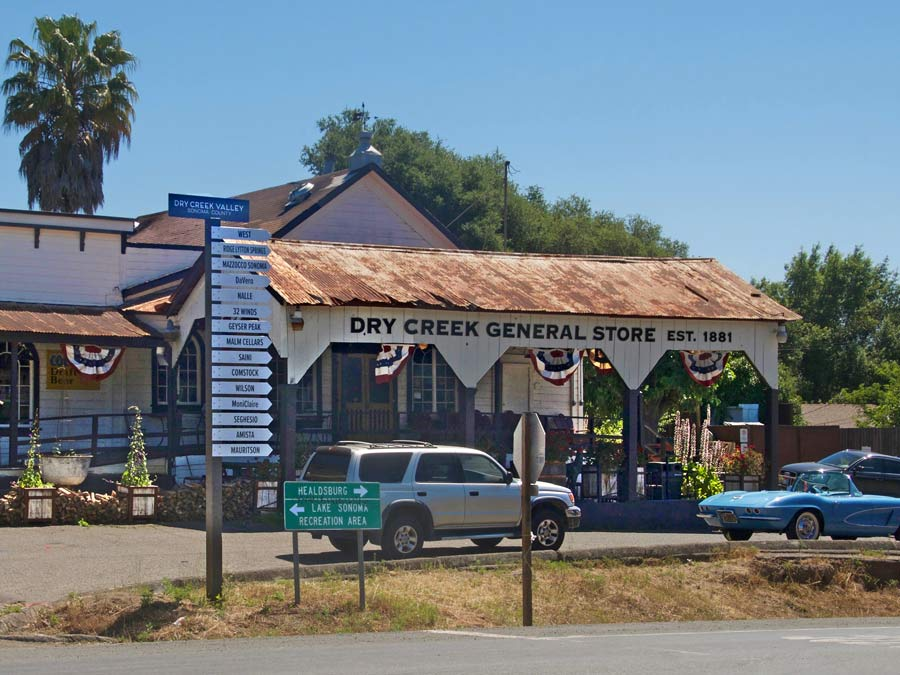 The old country store has a signnpost with winery names on it in Dry Creek Valley, Sonoma County
