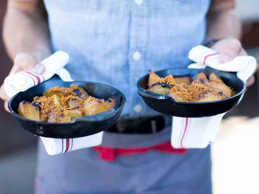 A server delivers two cast iron skillets of comfort food at Glen Ellen Star, Glen Ellen