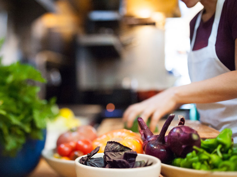 A chef preps dinner with fresh vegetables at Lowell's, Sebastopol