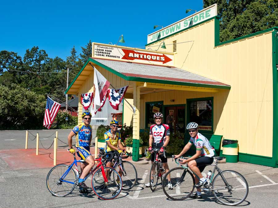 Cyclists pause in front of the Jimtown Store, Healdsburg