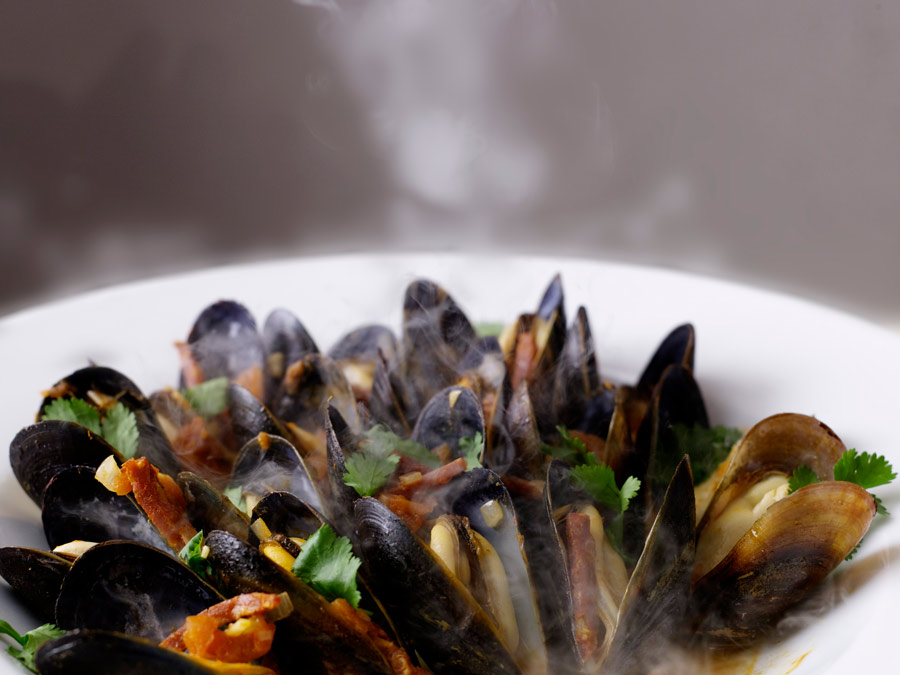 A steaming dish of mussels at LaSalette Restaurant, Sonoma