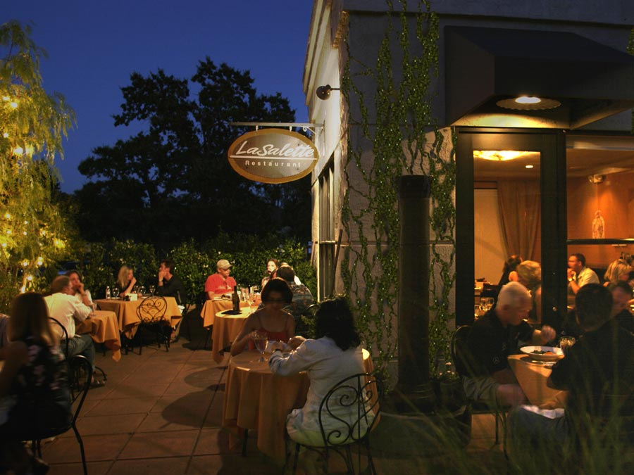 Diners are seated outside under the moonlight at LaSalette Restaurant in Sonoma County