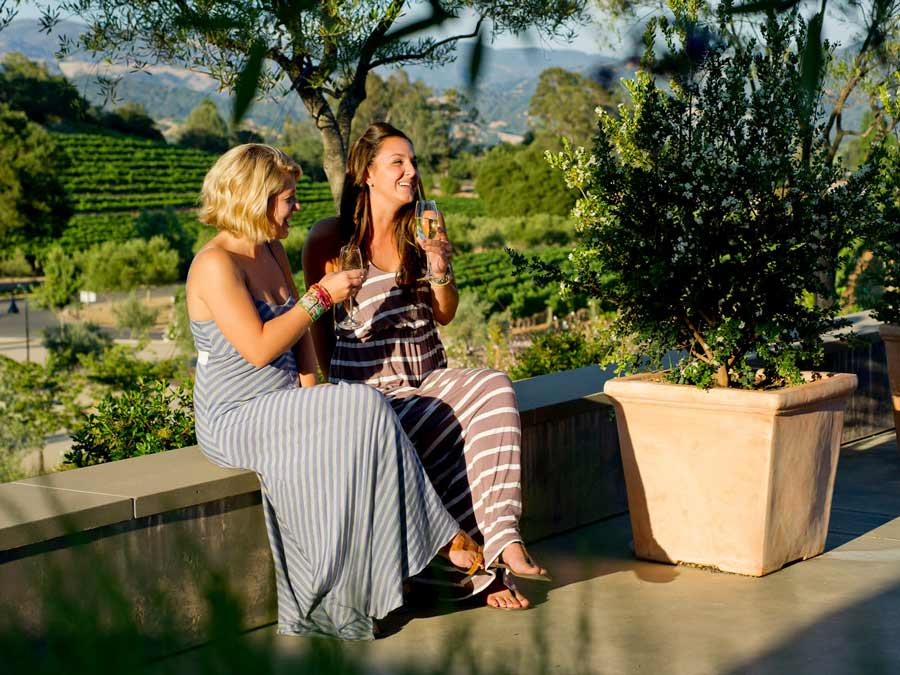 Two women enjoy a glass of wine on the patio at Rustic in Geyserville