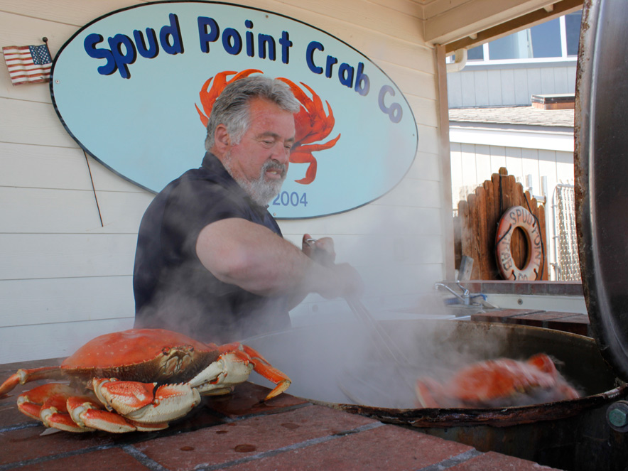 man cooking crab in Bodega Bay in Sonoma County