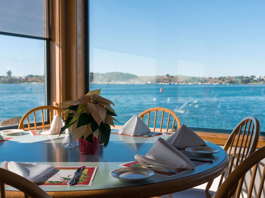 A sunny window seat looks out to the Pacific Ocean at the Tides Wharf Restaurant, Bodega Bay