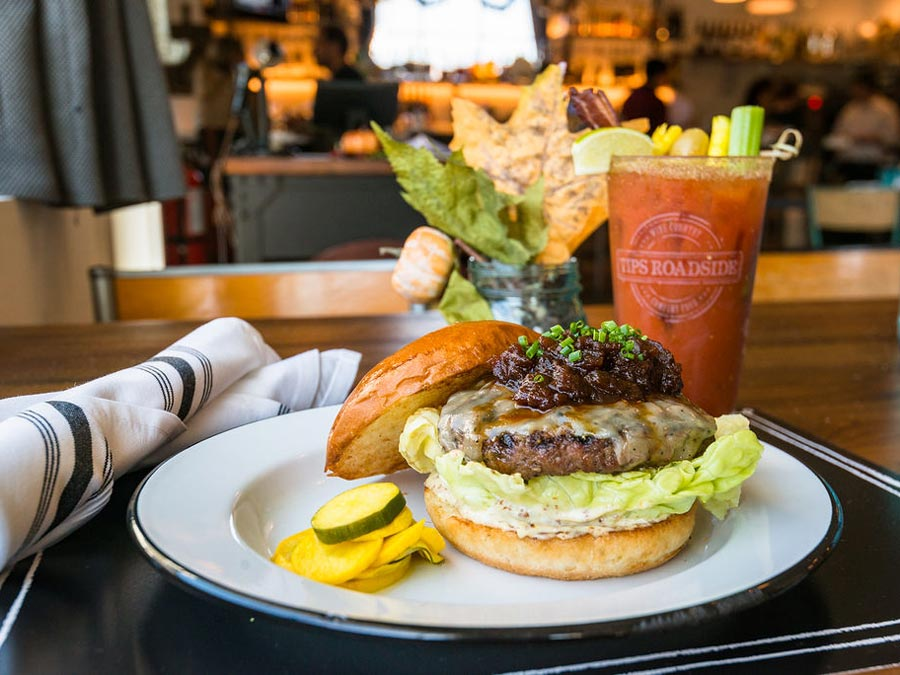 A bloody mary and a cheeseburger look absolutley delicious from Tips Roadside in Kenwood