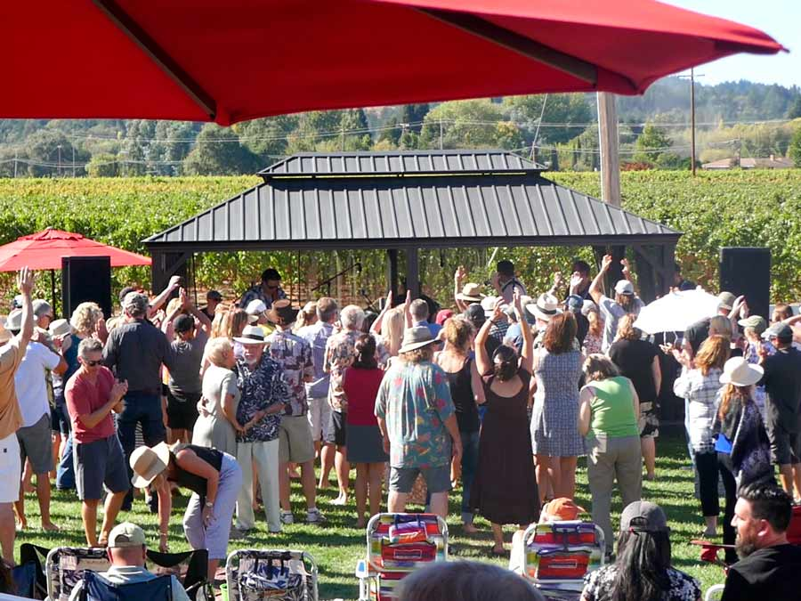 People dance to the music at the Geyser Peak Winery Summer Concert Series, Healdsburg
