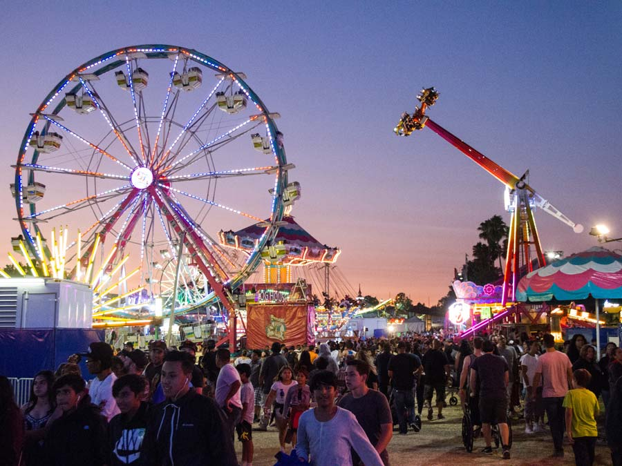 People enjoy carnival rides at dusk at the Sonoma County Fair, Santa Rosa