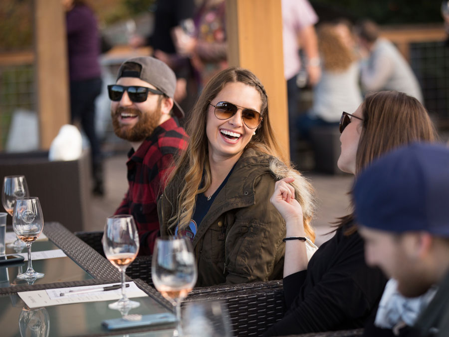 People enjoy wine around a table at the event Wine and Food Affair, Sonoma County