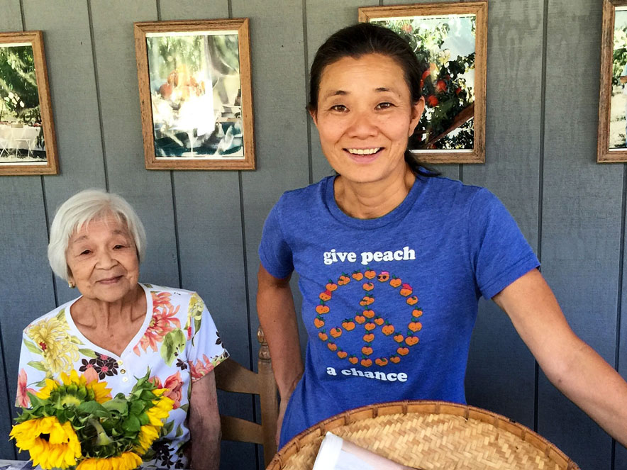 Two women from Dry Creek Peach & Produce.