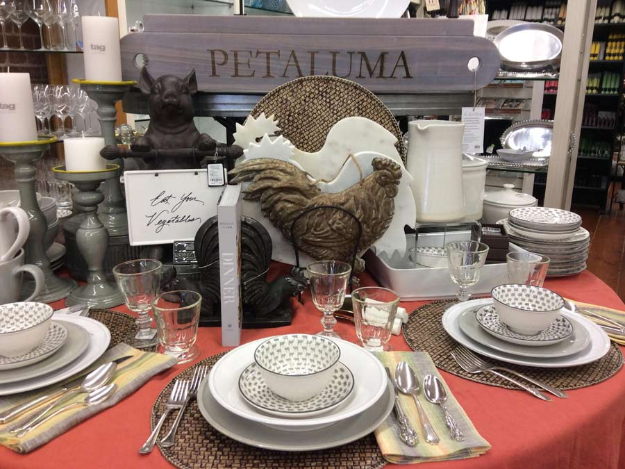 A table inside the store is covered with a place setting